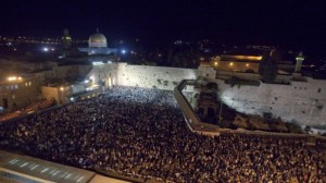Thousands of Jewish people gather for prayers at the Western Wall in Jerusalem's Old City the night before Yom Kippur, the Jewish Day of Atonement. (photo credit: Dror Garti/Flash90/Times of Israel.)