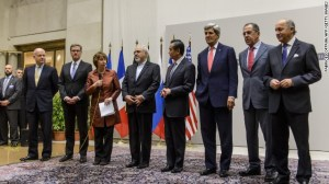 Chief negotiator Catherine Ashton and Iran's foreign minister announce agreement on Iran's nuclear program early on Sunday, November 24 in Geneva. (Getty Images/CNN)