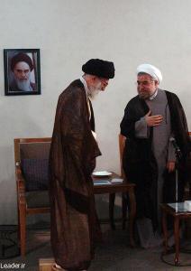 The Ayatollah Khamenei with new President Hassan Rouhani, standing near photo of the late-Ayatollah Khomeini.