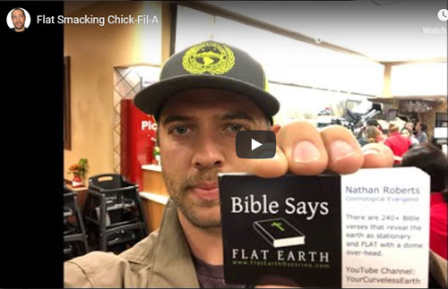 Nathan Roberts hands out Flat Earth business cards, that proclaim that he's a Cosmological Evangelist.
