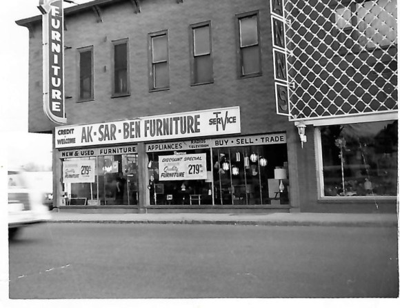 Black and white building photo of Aksarben Furniture and Television Repair, shown in 1962