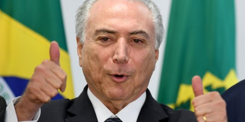 Brazilian acting President Michel Temer gives the thumbs up during a meeting with mayors at the Planalto Palace in Brasilia, on July 13, 2016. / AFP / EVARISTO SA (Photo credit should read EVARISTO SA/AFP/Getty Images)