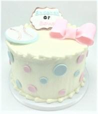 baseball or bows gender reveal cake