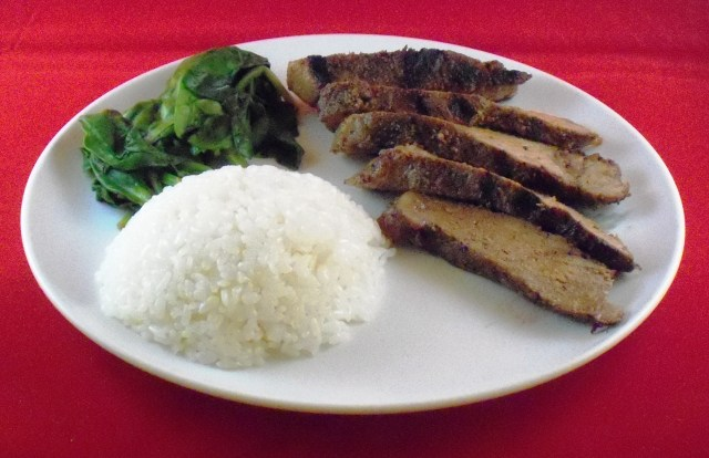 Image of a plate of steak and white rice with spinach