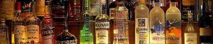 Image of miscellaneous liquor bottles arranged behind a bar