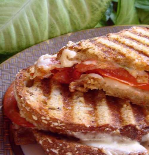 These Caprese Panini Mozzarella Tomatoes and Basil are just some crunchy cheesy goodness in sandwich form!!