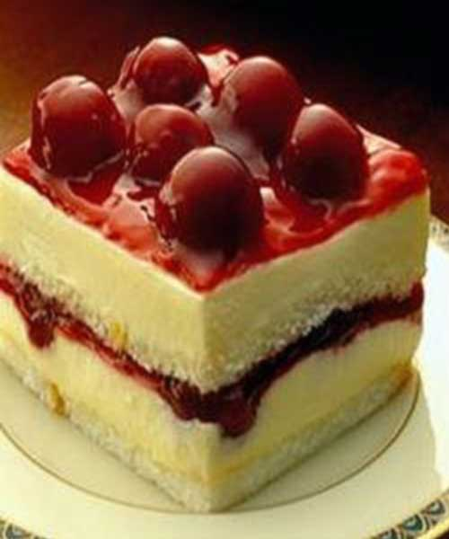 This Cherry angel cream cake is one of the tastiest cakes ever. It is a perfect blend of cream, milk and cherry. #cherry #cake #dessert