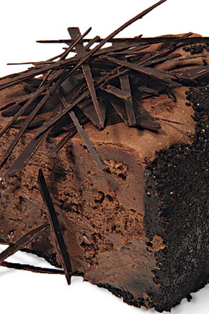 You can't get more chocolate than this Extreme Chocolate Cheesecake: a chocolate-wafer crust, melted dark chocolate in the filling, and chocolate shards scattered over the top. #chocolate #cheesecake #dessert