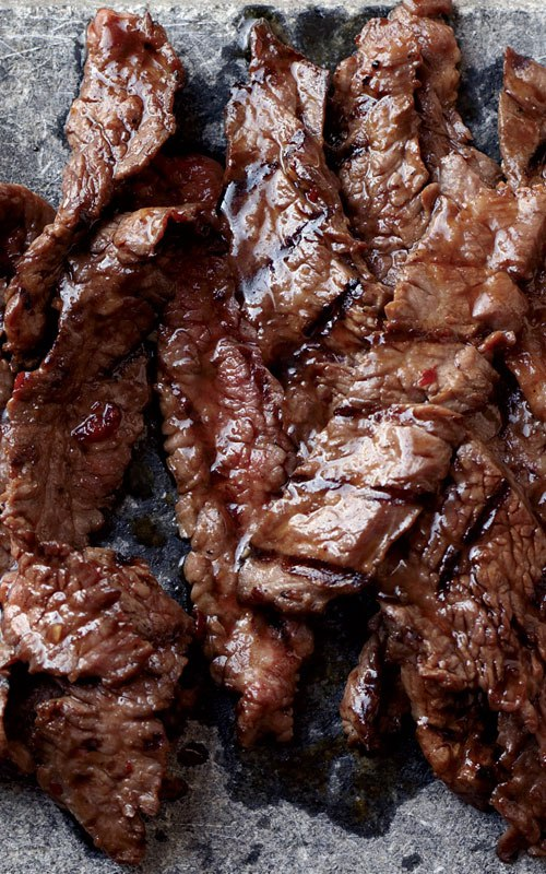 This succulent Korean Sizzling Beef recipe is based on bulgogi, a classic Korean dish of sliced beef that's marinated in soy sauce, sugar, sesame oil and garlic, then grilled.