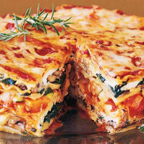 This Mile High Veggie Lasagna Pie is stacked with fresh vegetables, baby greens, aromatic herbs, three kinds of Italian cheeses, and a rich, hearty tomato-basil sauce. It's ideal for a special-occasion dinner.
