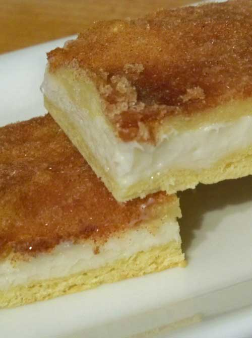 "Recipe for Sopapilla Cheesecake Bars - This is a South Texas favorite. Everytime I make them, they disappear faster than you can say ""hola"""