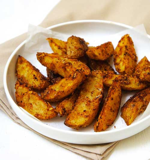 Recipe for Parmesan Potato Wedges - These oven baked Parmesan Potato Wedges are perfectly crisp and tasty. The potatoes are tossed together with Parmesan cheese before baking.