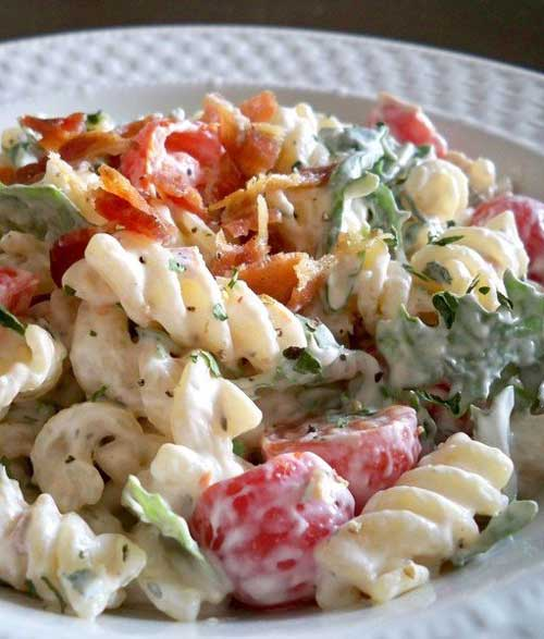 I humbly submit for your approval BLT Pasta Salad. It combines subtle herbs with peppery arugula and fresh tomatoes, all held together by a creamy base. Most importantly, it's finished with a modest portion of ever-delicious bacon
