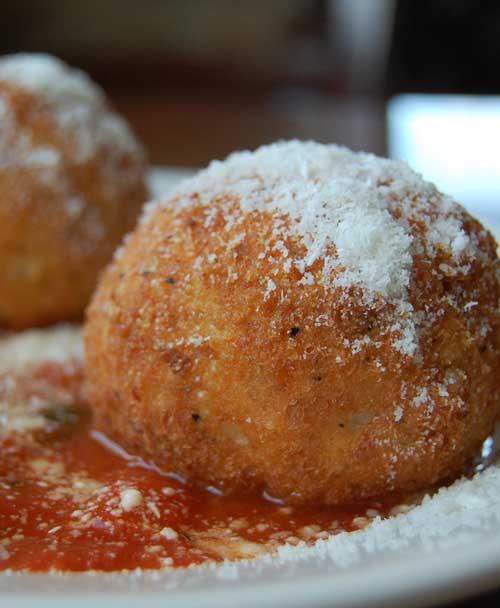 Recipe for Pesto Arancini Stuffed with Mozzarella – Rice Balls - Italian rice balls made with white wine risotto, and a gooey mozzarella center. Fantastic for lunch or dinner!
