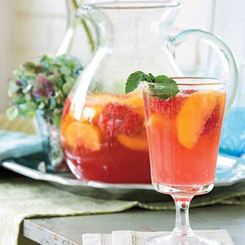 Recipe for Carolina Peach Sangria - Peaches put a Southern twist on this classic sparkling cocktail. Make the sangria the day before to allow the flavors to blend. Garnish with fresh mint.