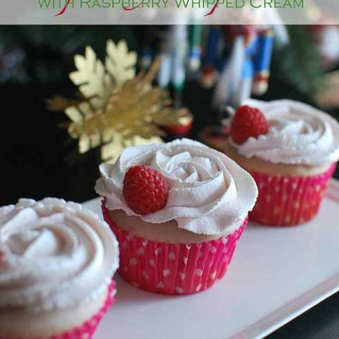 Recipe for Raspberry Cupcakes with Raspberry Whipped Cream - Raspberry Cupcakes that were flavored with fresh raspberry puree. And instead of your standard buttercreams, they are topped with rosette swirls of raspberry flavored whipped cream.