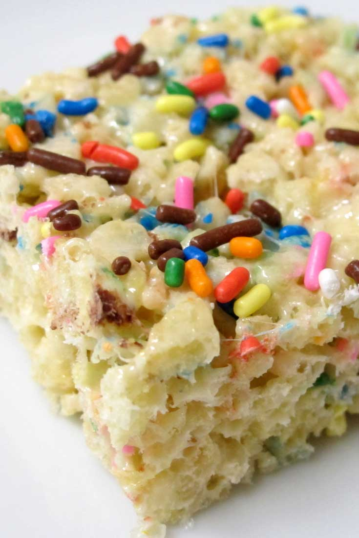 This Cake Batter Rice Krispie Treats recipe brings back a favorite sticky childhood treat, combined with the fun of licking the cake batter spoon. #ricekrispies #ricecereal #cakebatter #dessert