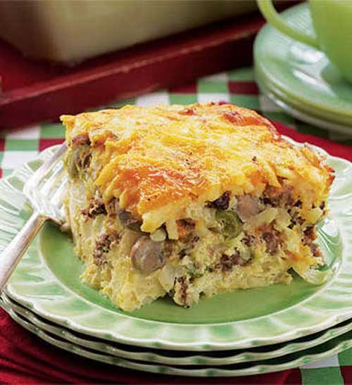 Recipe for Company Breakfast Casserole - For a southwest flair, replace the mushrooms with a small can of sliced olives, add Monterey Jack cheese instead of Cheddar and serve with spicy salsa on the side.
