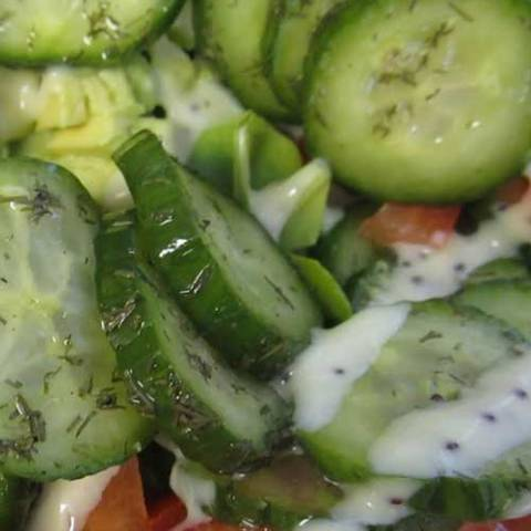 Recipe for Cucumber Garden Salad - This light and delicious salad is just perfect. Make some extra, and enjoy the leftovers for lunch the next day!