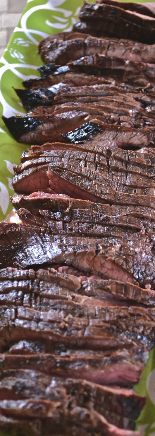 A super simple Grilled Balsamic Flank Steak recipe, that packs a HUGE flavor punch. #grilledsteak #grillingrecipe #steakrecipe #beef