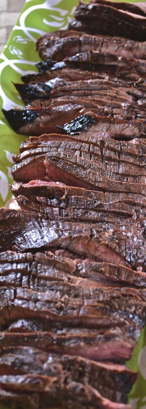 A super simple Grilled Balsamic Flank Steak recipe, that packs a HUGE flavor punch. #grilledsteak #grillingrecipe #steakrecipe #beef