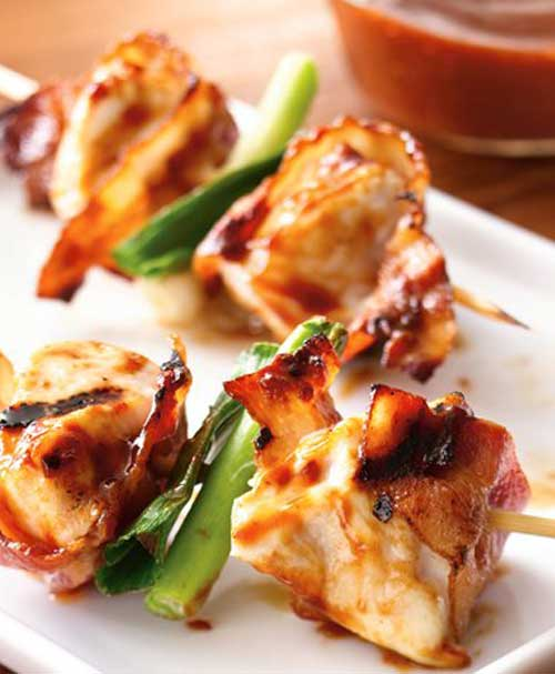 Here is a super simple recipe that helps you to turn four everyday ingredients into an extraordinary appetizer. These Grilled Bacon Chicken Skewers are a must try at any barbecue.