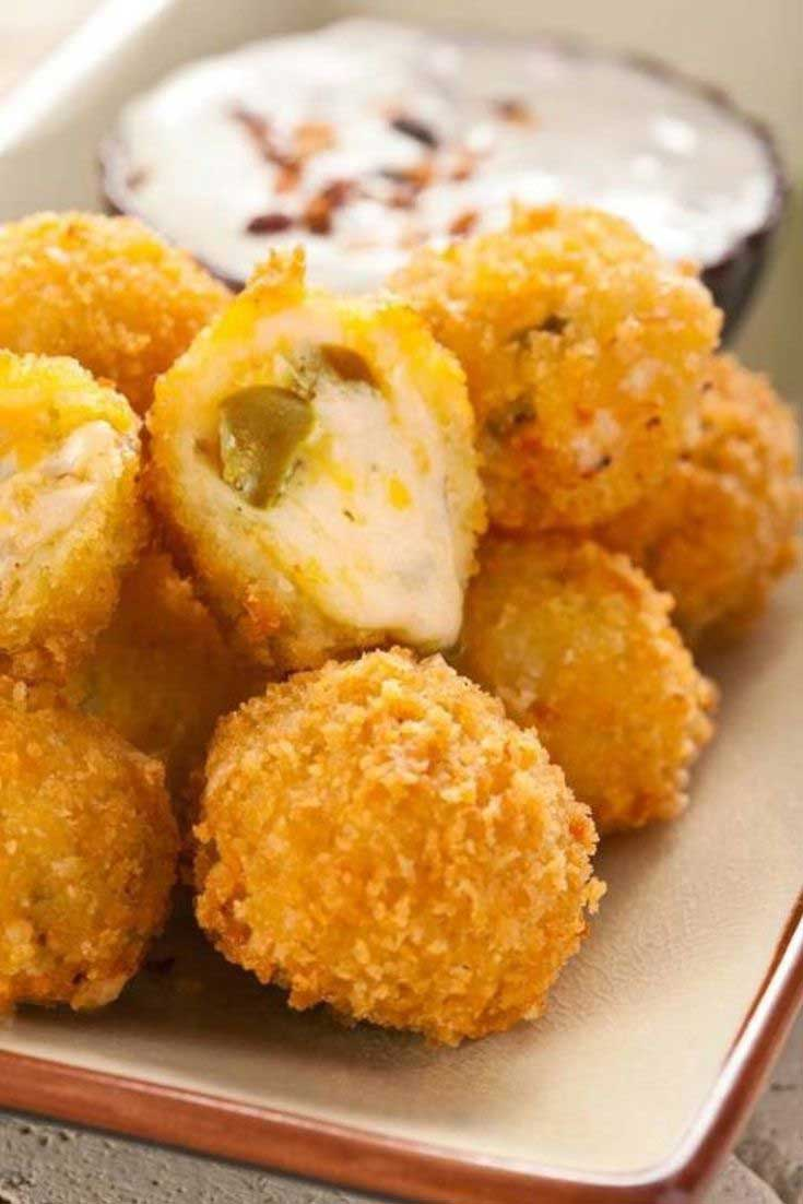 These Jalapeno Cheese Fritters are the ultimate appetizer. Gooey cheese and jalapenos in a crunchy shell. What more could you want? #jalapeno #cheese #appetizers #partyfood