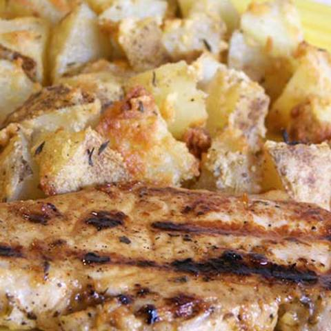 Recipe for Grilled Lemon Herb Pork Chops with Parmesan Roasted Potatoes - Pork and potatoes is such a classic combination. And with this pair of recipes, you will find out why, in such a yummy way.