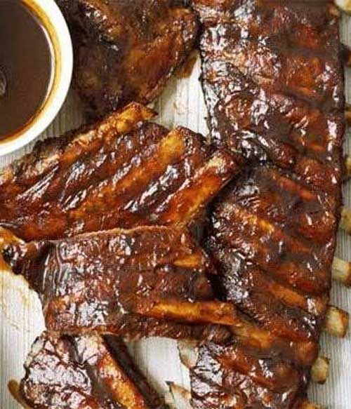 The caramel and spice flavors of this fizzy drink add a finger-lickin' irresistibility to these sticky Dr Pepper Ribs!