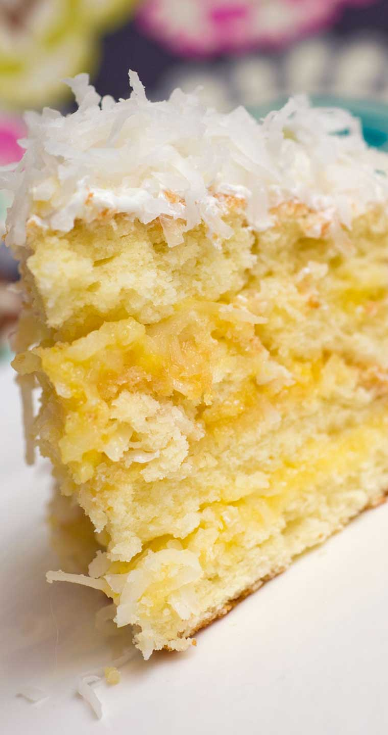 The citrusy note of this Lemon-Coconut Cake, along with it's perfect texture...I am starting to drool just thinking about it! #lemon #coconut #cake #dessert