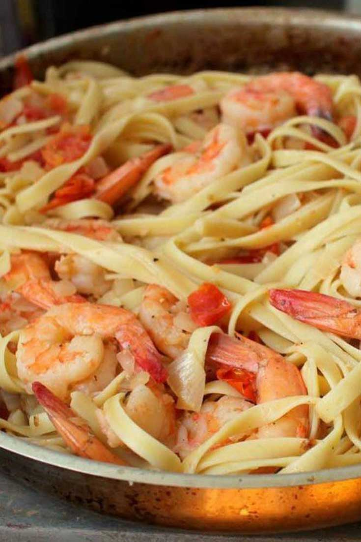 The key to this super simple sauce is the tiny tomatoes. Not only are they an easy ingredient to work with, they also lend a slight sweetness to this Shrimp Fettuccine in Cherry Tomato Sauce. #pasta #shrimp #dinnerideas