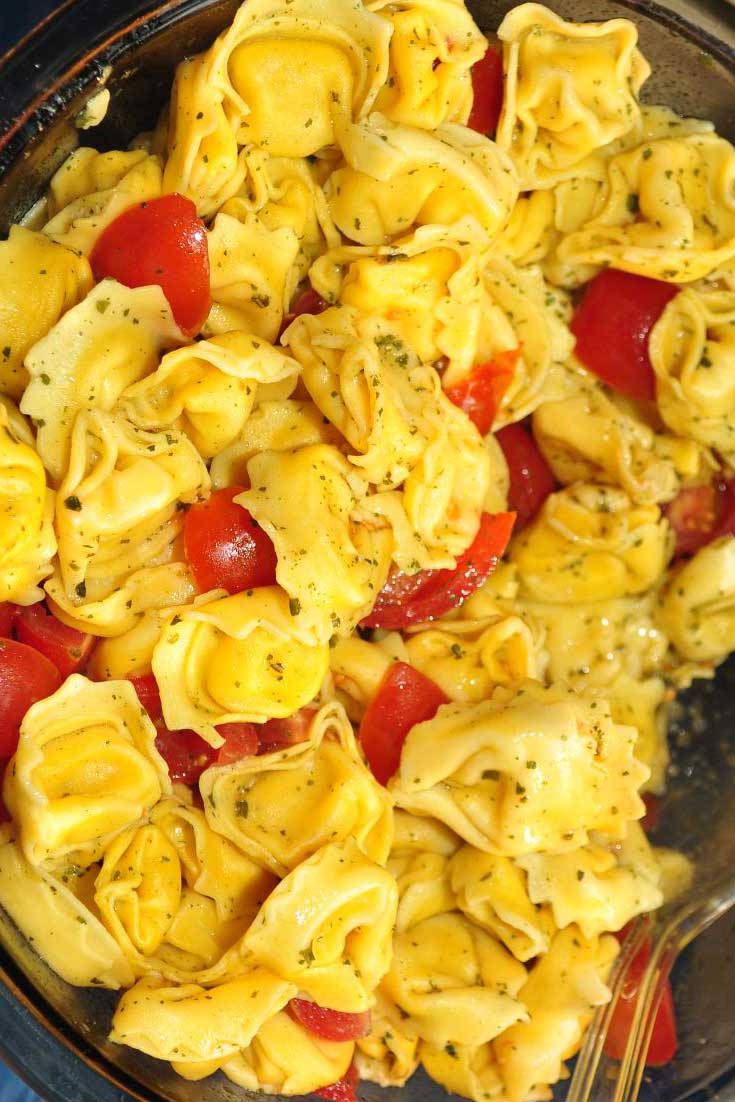 Refrigerated cheese tortellini gives you a jump start on serving this easy Tortellini Antipasto Salad to a soon-to-be adoring crowd. #tortellini #easyrecipe #sidedish #pasta