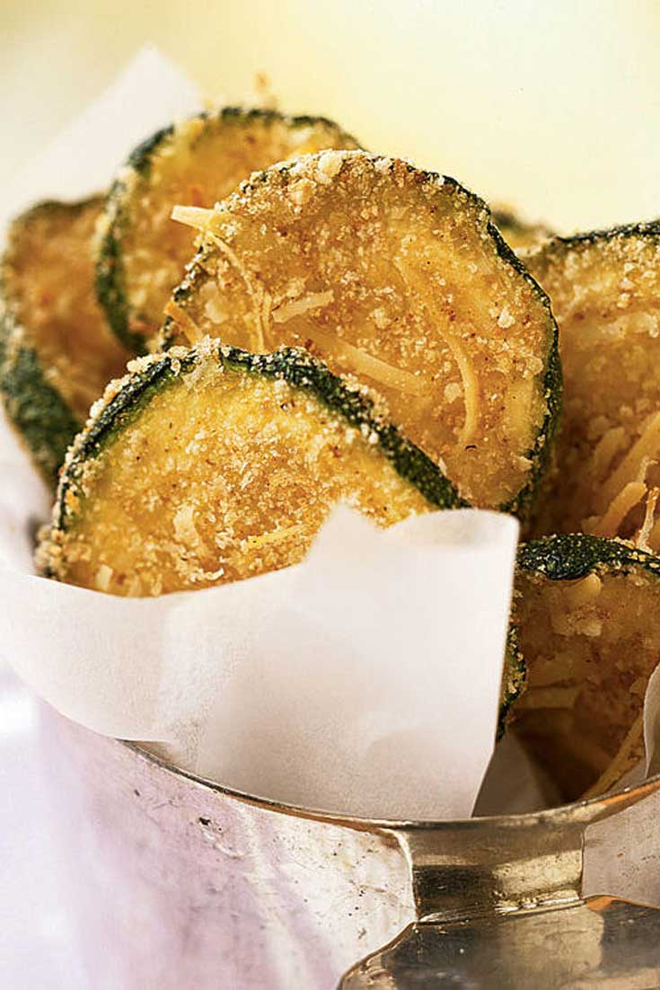 Breaded, oven-fried zucchini chips taste like they're fried, yet they are baked and amazingly crispy. These chips make a healthy substitute for fries or potato chips. #zucchini #snack #healthy