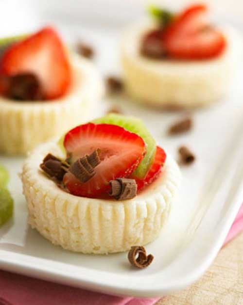 Recipe for Low-Cal White Chocolate Mini Cheesecakes - We gave this recipe for mini cheesecakes a healthy makeover to make these creamy, dreamy morsels guilt-free. Enjoy!