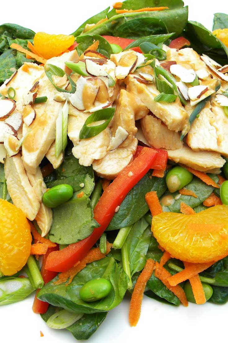 Loaded with fresh, vibrant veggies, tender poached chicken and a flavorful dressing, this Asian Chicken and Spinach Salad makes for a satisfying meal. #chicken #spinach #salad