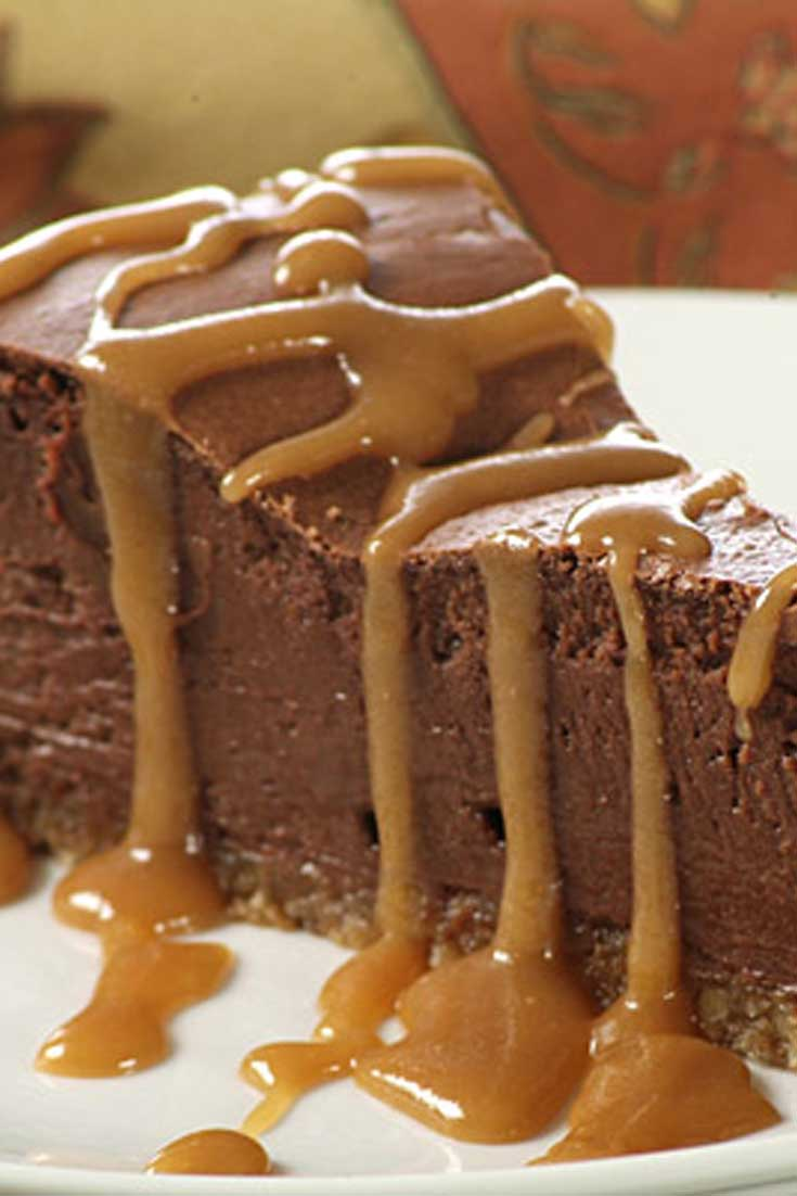 Served with caramel sauce this delicious French Chocolate Cheesecake is sure to please all the chocolate lovers in your family! #chocolate #cheesecake #dessert
