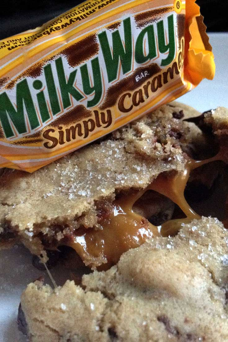 Salted Caramel is all the rage lately! Here is a chocolate chip cookie that is updated with the sweet Milky Way Simply Caramel fun size candy bars and Sea Salt, of course! #cookies #dessert #caramel #chocolate
