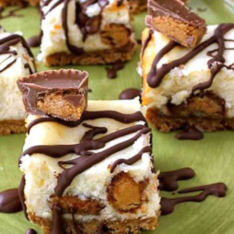 Recipe for Peanut Butter Cup and Chocolate Cheesecake Bars - After adding chopped Peanut Butter Cups to the filling, and drizzling the baked bars with melted chocolate; I was rewarded with a bar that was delicious beyond words!