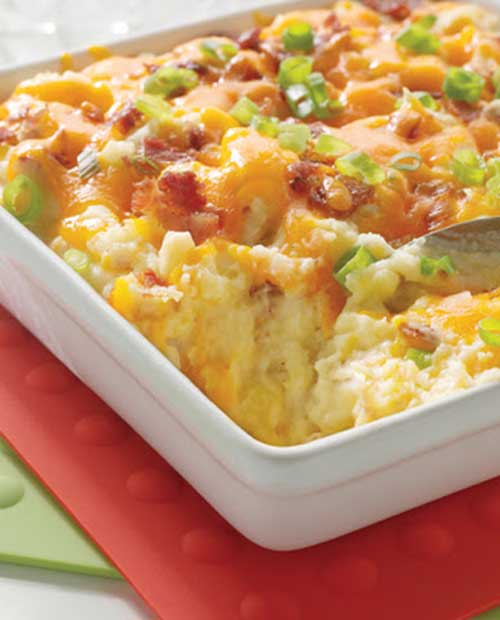 Recipe for Baked Potato Casserole - This Baked Potato Casserole has creamy potatoes, cheddar cheese and turkey bacon blended together and baked to perfection. This side dish is sure to put a smile on everyone's face