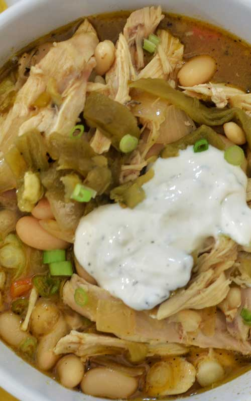"""This White Bean and Turkey Chili is one of those """"killer"""" recipes that will wow any crowd, all while helping you use up that leftover turkey!"""