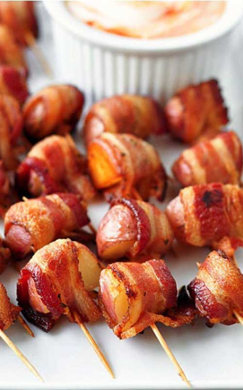 The perfect party food...Bacon Wrapped Rosemary Potatoes! This is my goto recipe for any party, and they ALWAYS disappear!