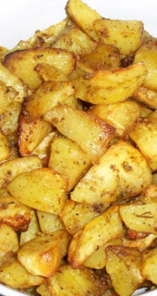 These Oven Roasted Garlic Potatoes have become a family favorite. The potatoes roast slowly in a bath of lemon and olive oil, soaking up all the garlic-y goodness! #potatoes #sidedish