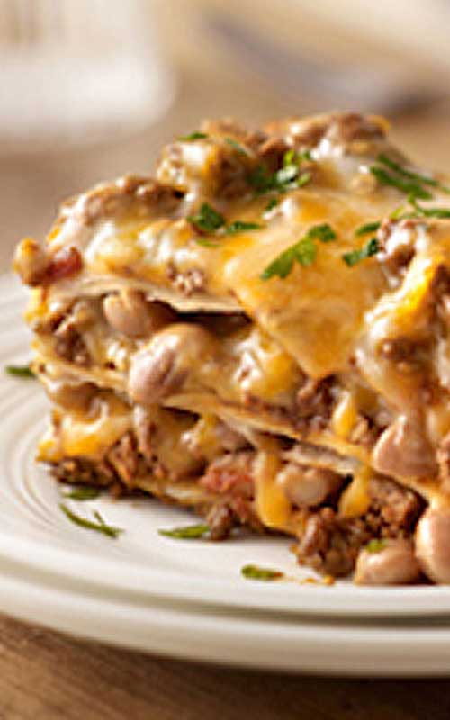 Create a little fusion with ooey-gooey cheese, beans and taco beef layered up and baked into Our Favorite Mexican-Style Lasagna.