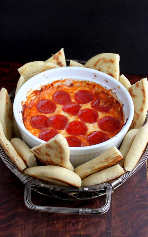 Recipe for Lazy 4-Layer Deep Dish Pizza Dip - This pizza dip would make a great and easy addition to any party or get together. Or you could even make it as a quick after school snack!