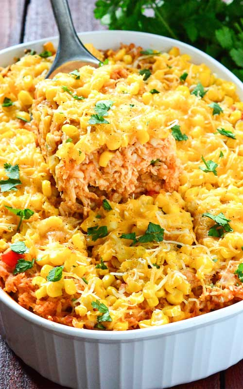 All the makings of a cheesy, bold, chicken enchilada in a comforting rice casserole form make this Chicken Enchilada Rice Casserole a perfect idea for dinner!