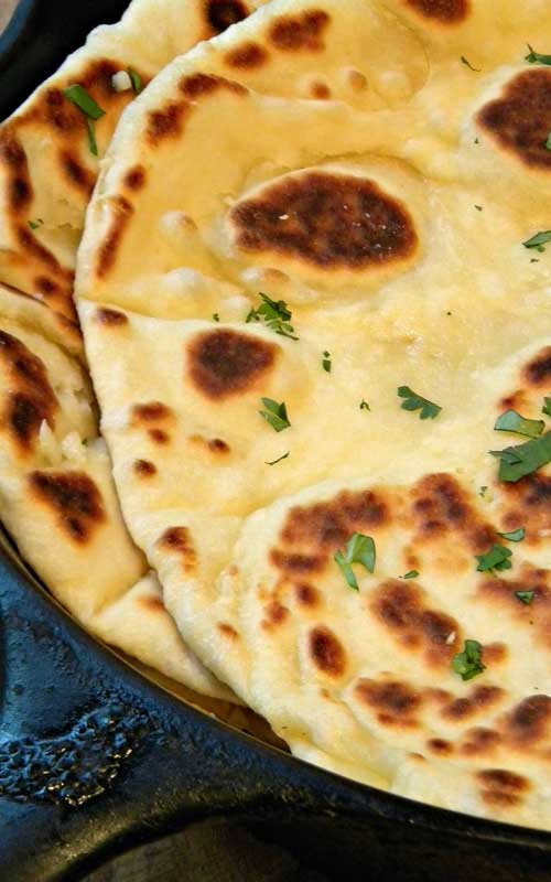 The aroma of fresh cooking garlic naan slathered in warm garlic-butter is mouth-watering! Perfect for garlic lovers and Indian Cuisine Fanatics!