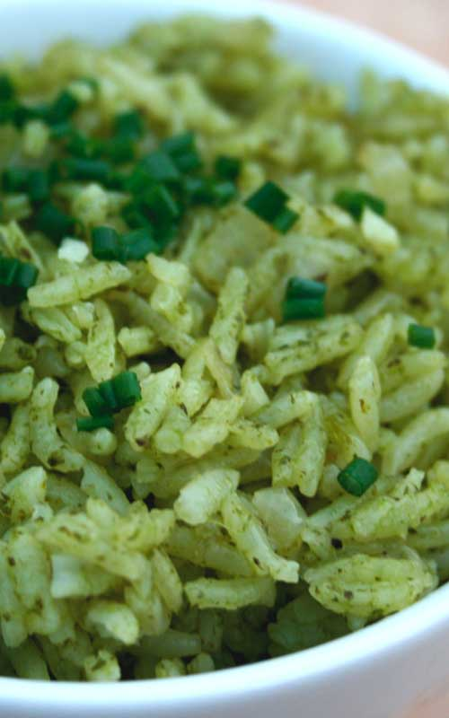 """This Garlic & Herb """"Green"""" Rice is a nice Mexican twist on boring old rice. A good accompaniment for just about any main course, especially grilled meats."""