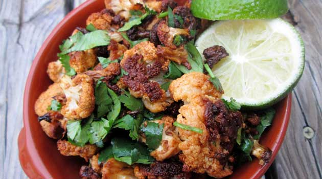 Recipe for Mexican Roasted Cauliflower - This side dish is a must next time you make Mexican food...or even just plain grilled chicken! And don't forget the lime - it takes the cauliflower to a whole new level.
