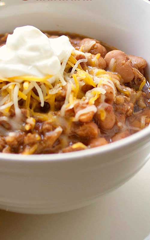 This hearty Crock Pot Chili with Beans has a mild flavor, perfect for families with kids. It's easy to customize and add your favorite toppings.