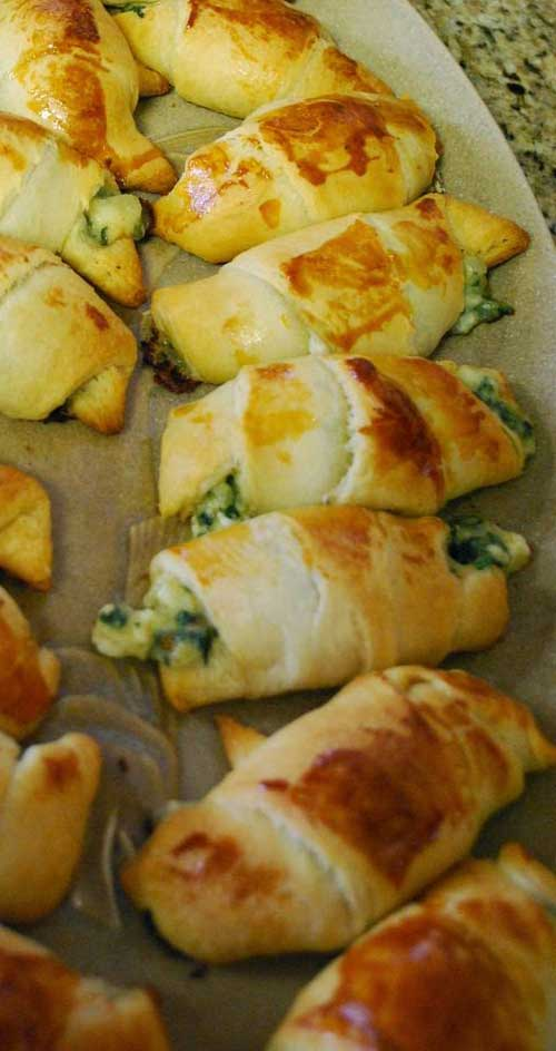 These Windy City Crescent Rolls are simple to make and super yummy. Served warm and gooey and stuffed with feta and spinach, it's hard to eat just one! #appetizer #partyfood